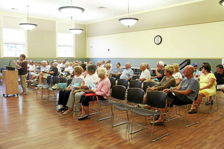 City residents attend a revaluation information meeting Monday at City Hall in Torrington. Photo: Esteban L. Hernandez — The Register Citizen