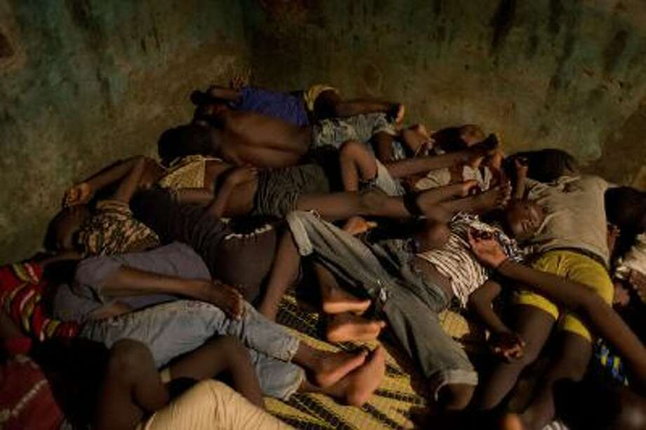 Islamic students sleep together in the crowded room that serves as their classroom and living quarters in Dakar, Senegal, on Sept. 24.