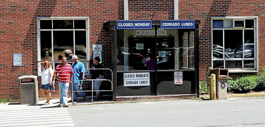 People exit the Wethersfield, Conn., offices of the Connecticut Department of Motor Vehicles. Photo: AP Photo/Bob Child