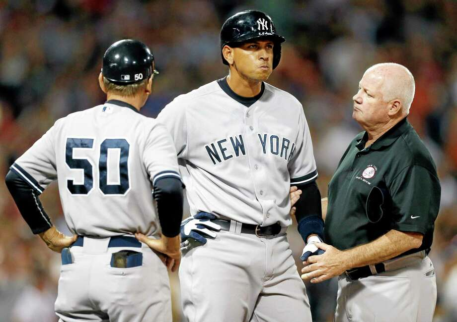 Alex Rodriguez, center, declined Major League Baseball's challenge to make public the drug evidence that led to his 211-game suspension. Photo: Michael Dwyer — The Associated Press  / AP