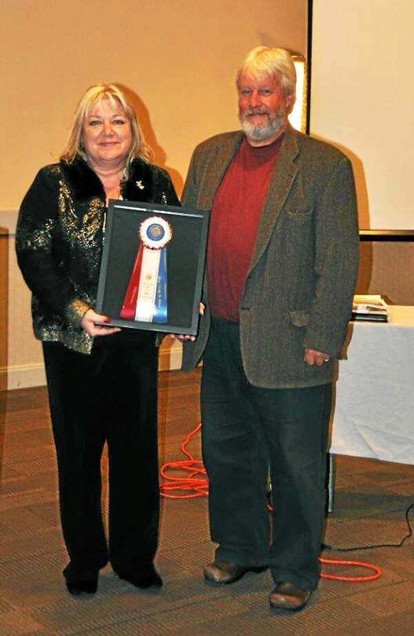 Craig Miner, the AKC Legislator of the Year, receives the award from Laurie Maulucci, president of the Connecticut Dog Federation. Photo: Contributed Photo