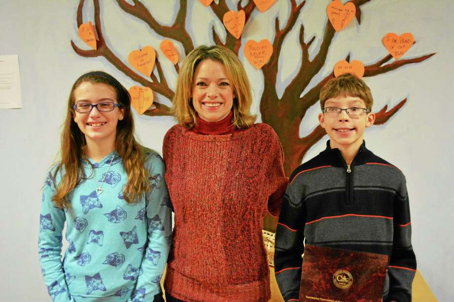 Pearson School Principal Barbara Silverio stands with the two awardees, sixth-graders Gavin Langston and Rebecca Dowling. Photo: Ryan Flynn — Register Citizen