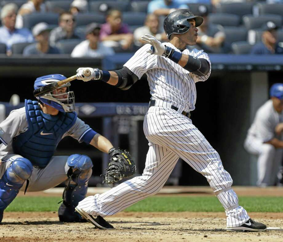 New York Yankees' Robinson Cano looks after a three-run homer during the third inning of the baseball game against the Toronto Blue Jays at Yankee Stadium Tuesday, Aug. 20, 2013 in New York. (AP Photo/Seth Wenig) Photo: AP / AP