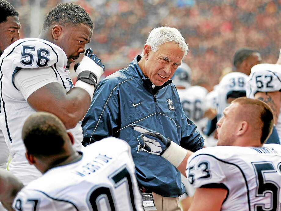 The Associated PressUConn head coach Paul Pasqualoni talks with his players. Photo: AP / AP2012