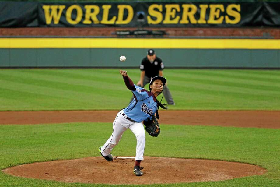 Philadelphia pitcher Mo'ne Davis delivers in the first inning of a United States semifinal game against Las Vegas on Wednesday at the Little League World Series in South Williamsport, Pa. Davis' success is a great story, but Register sports columnist Chip Malafronte doesn't disagree that a lot of attention at a young age doesn't always work out for the best. Photo: Gene J. Puskar — The Associated Press  / AP