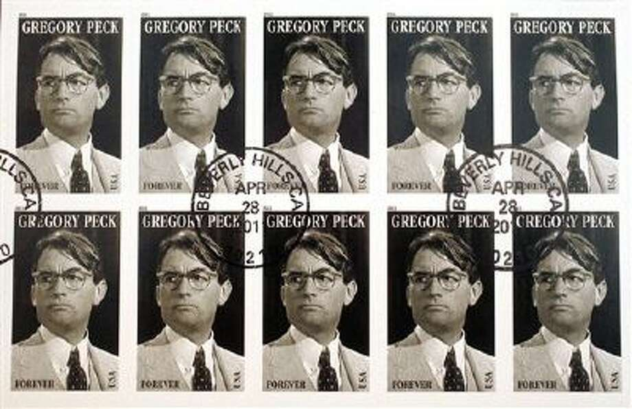 """The U.S. Postal Service first-day-of-issue Gregory Peck Forever stamp is displayed at the Academy of Motion Picture Arts and Sciences in Beverly Hills, Calif., Thursday, April 28, 2011. The Gregory Peck stamp is the 17th in the USPS's """"Legends of Hollywood"""" series. It features Peck as Atticus Finch in the 1962 film: """"To Kill a Mockingbird."""" (AP Photo/Damian Dovarganes) Photo: ASSOCIATED PRESS / AP2011"""