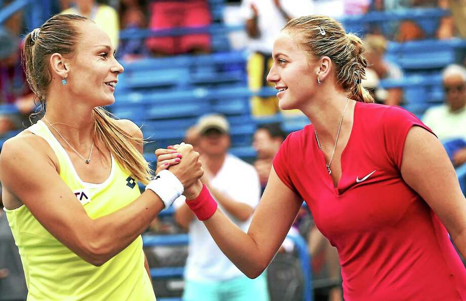 (Peter Hvizdak - New Haven Register) Magdalena Rybarikova, left, congratulates Petra Kvitova after she was defeated by Kvitova  6-4, 6-2 at the Connecticut Open Women's single finals  August 23, 2014 at the Connecticut Tennis Center in New Haven. Photo: New Haven Register / ©Peter Hvizdak /  New Haven Register