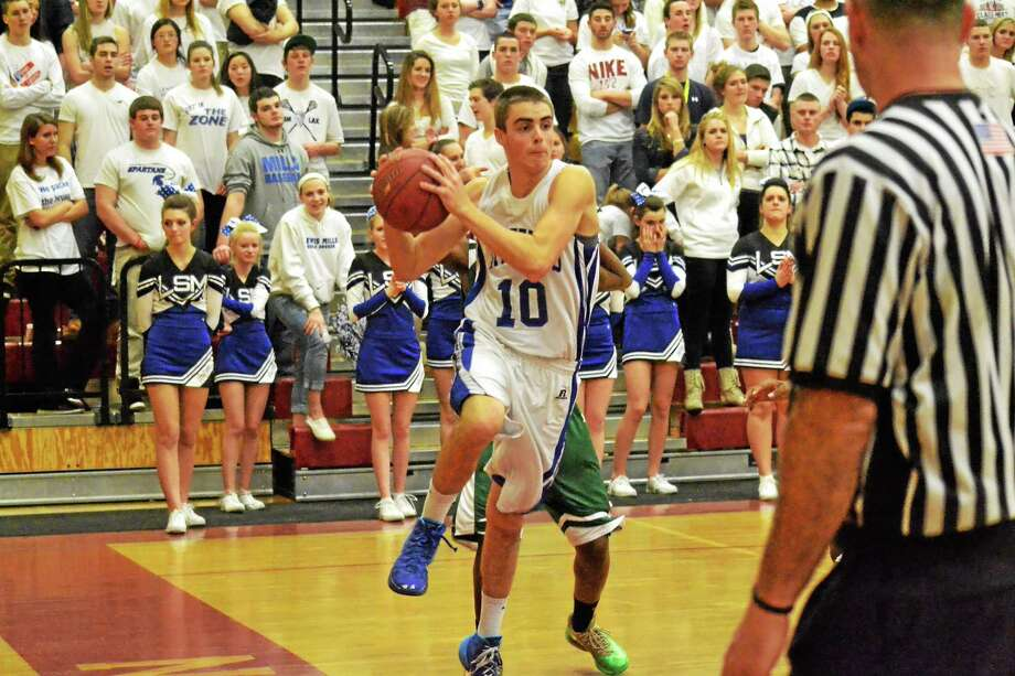 Lewis Mills's Alexander Daigle looks to make a pass. Daigle led the team with 15 points in the Spartans' 89-33 loss to Weaver. Photo: Pete Paguaga—Register Citizen