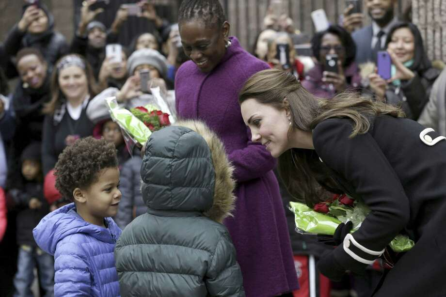 Kate, the Duchess of Cambridge, right, and Chirlane McCray, the first lady of New York City, center, receive flowers from Andrew, 5, left, and Mila, 6, before leaving the Northside Center for Childhood Development, Monday, Dec. 8, 2014 in New York.  Kate and Prince William arrived in New York City on Sunday, their first official visit to the U.S. since a 2011 trip to California and their first taste of the Big Apple. (AP Photo/Seth Wenig, Pool) Photo: AP / Pool