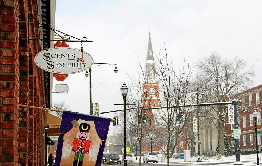 Outside Scents and Sensibility on Thursday in downtown Torrington. The Main Street gift shop is one of several local businesses that had a successful holiday shopping season. Photo: Esteban L. Hernandez — Register Citizen