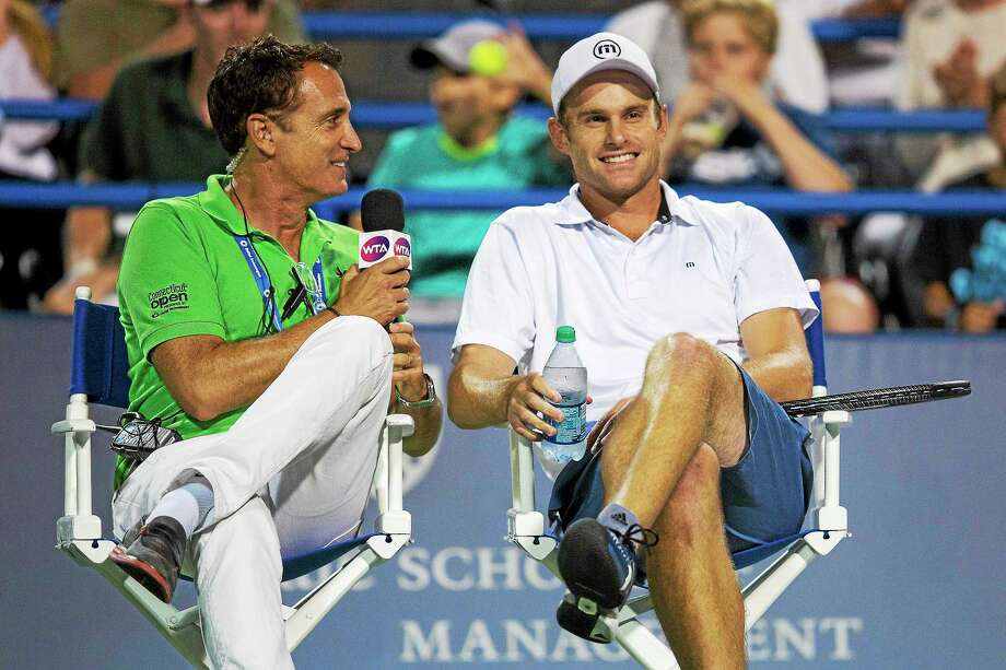Connecticut Open tournament emcee Andrew Krasny interviews Andy Roddick during his Legends exhibition match against James Blake on Thursday night. Photo: Billie Weiss — Connecticut Open  / ©2014 Billie Weiss/Connecticut Open