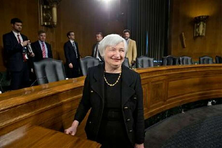 Janet Yellen, President Obama's nominee to succeed Ben Bernanke as Federal Reserve chairman, smiles after finishing her confirmation hearing before the Senate Banking Committee on Capitol Hill in Washington, Thursday, Nov. 14, 2013. Yellen, 67, is expected to be confirmed by the Democratic-controlled Senate before Bernanke steps down in January.  (AP Photo/J. Scott Applewhite) Photo: AP / AP
