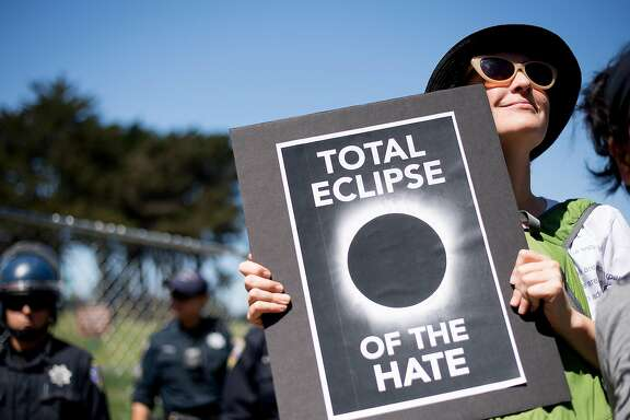 A protester, who declined to give her name, rallies in opposition to a planned conservative gathering on Saturday, Aug. 27, 2017, in San Francisco.