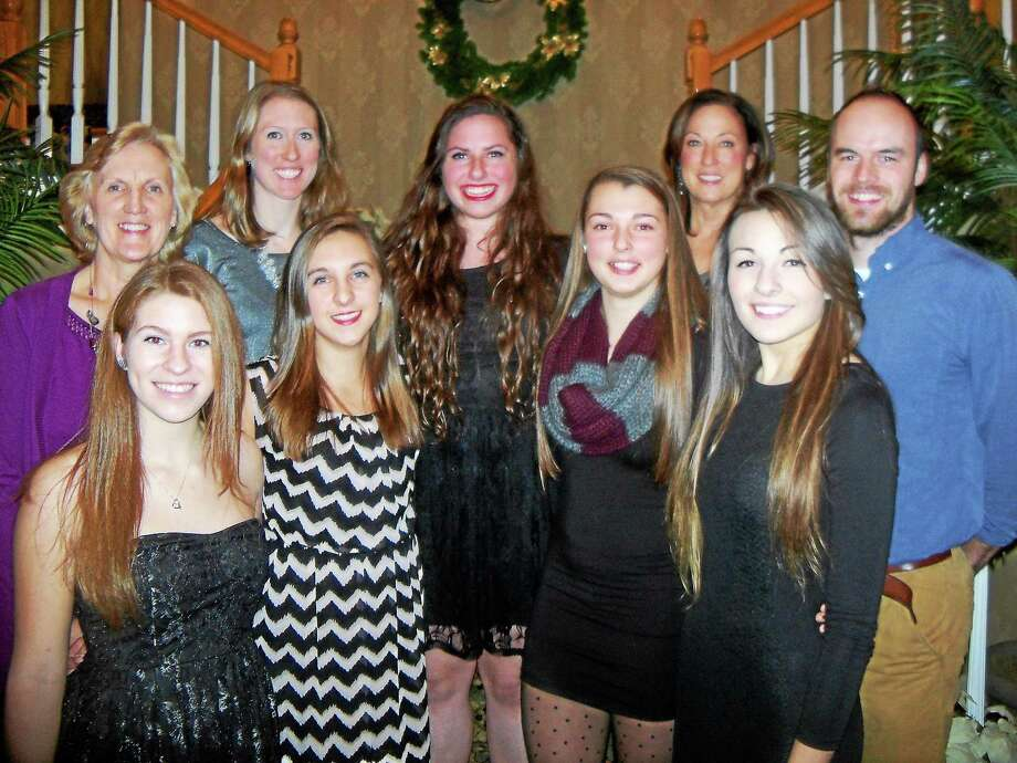 Torrington girls volleyball seniors and coaches at Sunday's banquet, front row from left: Carly Ruzbasan, Shelby Howe, Kassi Perusse, Samantha Zordan, Miah Giarnese; back row from left: Coach Pat Strawson, head coach Christine Gamari, coach Maryanne Musselman, coach Kyle Phalen. Photo: Peter Wallace — Register Citizen