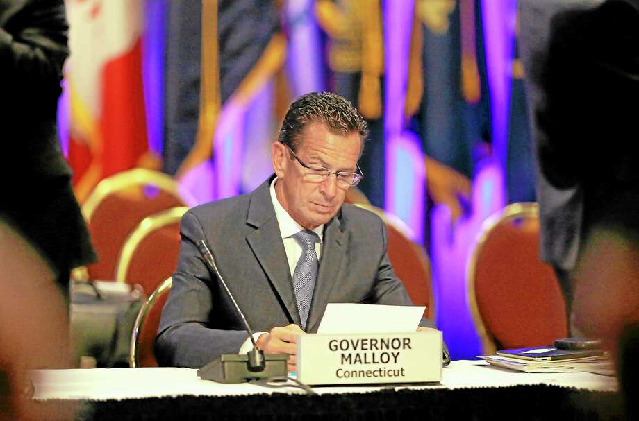 Gov. Dannel Malloy looks over some notes during a session of the National Governors Association meeting Sunday, Aug. 4, 2013 in Milwaukee. Photo: Morry Gash—The Associated Press  / AP