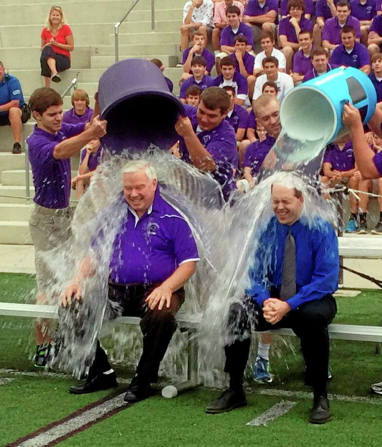 "In this Thursday, Aug. 21, 2014, photo provided by the Archdiocese of Cincinnati, Jim Rigg, right, superintendent of the diocese's 113 schools, and Elder High School Principal Tom Otten take the ice-bucket challenge at Elder High School in Cincinnati. The archdiocese is discouraging its students and staff from donating any money raised as part of the challenge to the ALS Association, saying the group funds a study involving embryonic stem cell research ""in direct conflict with Catholic teaching."" The diocese said schools could participate in the ice bucket challenge, but any money raised should be directed to groups like the John Paul II Medical Research Institute in Iowa City, Iowa, which conducts ""pro-life driven"" research, according to its website.   (AP Photo/Archdiocese of Cincinnati) Photo: AP / Archdiocese of Cincinnati"
