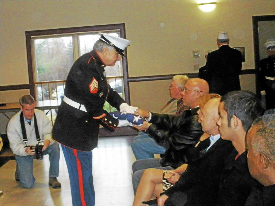 Photo by Stephen Underwood Family members of U.S. Army 2nd Lt. Albert Maiga and fellow veterans crowded inside Borough Hall in Bantam to pay their respects at a Veteran of the Month ceremony Saturday. Photo: Journal Register Co.