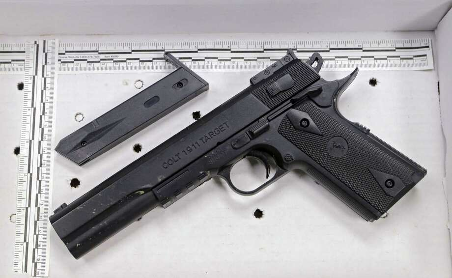 In a Nov. 26, 2014 photo, a fake handgun taken from 12-year-old Tamir Rice, who was fatally shot by Cleveland police, is displayed after a news conference in Cleveland. Photo: AP Photo/Mark Duncan, File  / AP