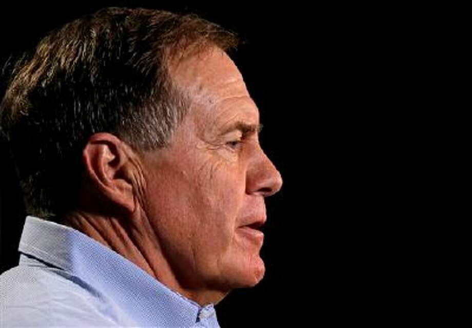 New England Patriots head coach Bill Belichick answers a question during a news conference at the NFL football scouting combine in Indianapolis, Thursday, Feb. 20, 2014. (AP Photo/Michael Conroy) Photo: AP / AP