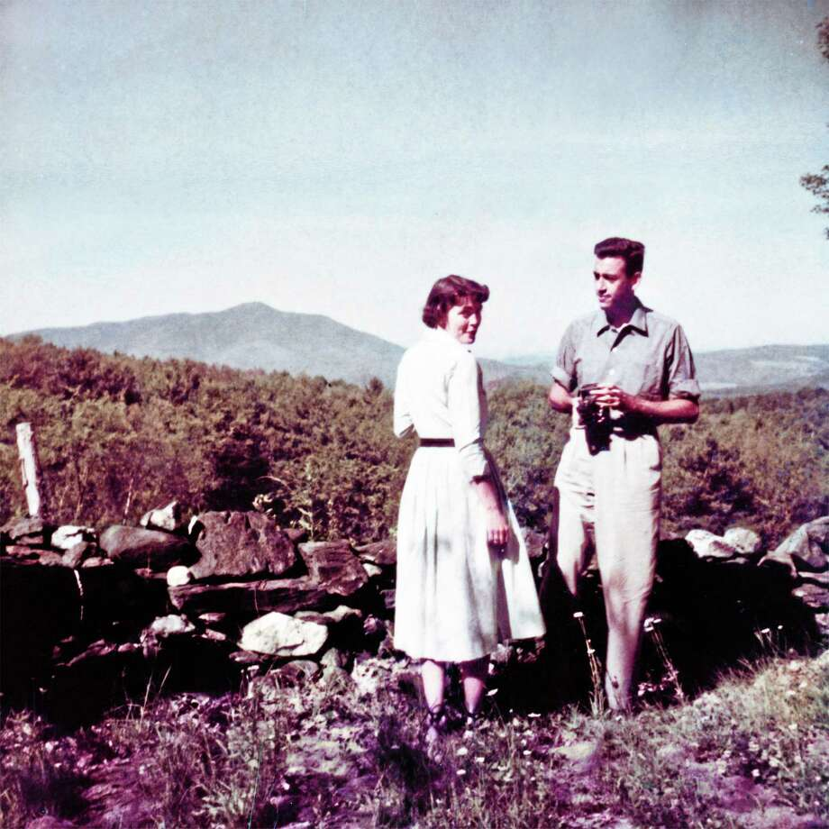 This undated photo provided by The Story Factory shows author J.D. Salinger at home in Cornish, N.H., with Emily Maxwell, the wife of William Maxwell, a close friend and Salinger's editor at The New Yorker. The photo, rarely seen until now, is part of a new documentary and book by filmmaker Shane Salerno. (AP Photo/The Story Factory) Photo: AP / The Story Factory