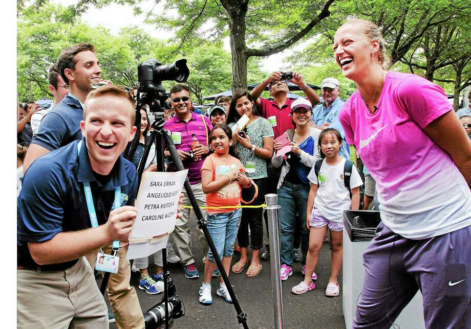 Jeff Watson, left, laughs with Petra Kvitova as they play a guessing game about her fellow players on Sunday at the Tennis Center at Yale. Photo: Melanie Stengel — Register