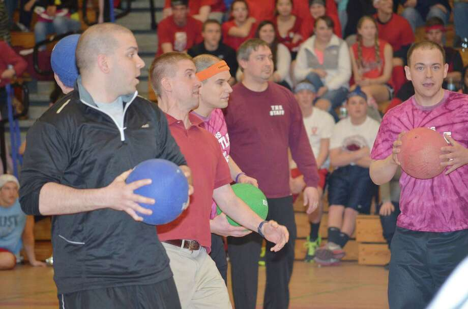 Some of the teachers at Torrington High School formed a team for the annual Interact Club's dodgeball game on Friday. From left to right Bruce Harrison, Andrew Marchand, Mike Schieb, Mike Deleppo and Michael Benedict. ¬ The game is a funderaiser held each year to raise money for Generation Rwanda. This is the eighth year the club has held this fundraiser. Photo: Register Citizen File Photo