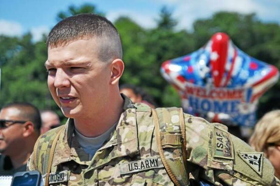 Sgt. Jonathan Miscikoski was one of five Torrington men to return home from Afghanistan Thursday as the 1048th Transportation Company of the Connecticut National Guard landed in East Granby. (Tom Caprood-Register Citizen)