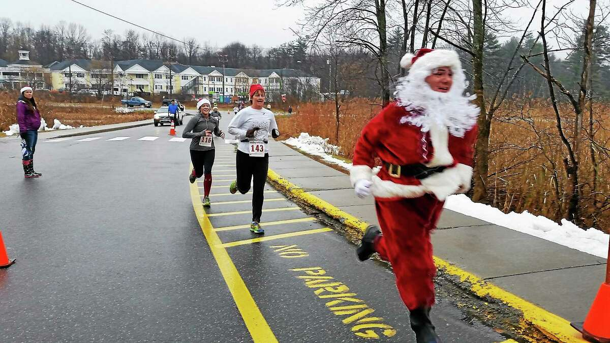 An unidentified runner runs during the 32nd annual Jingle Bell Run at Litchfield Intermediate School at 35 Plumb Hill Road in Litchfield on Saturday. Photo - NF Ambery