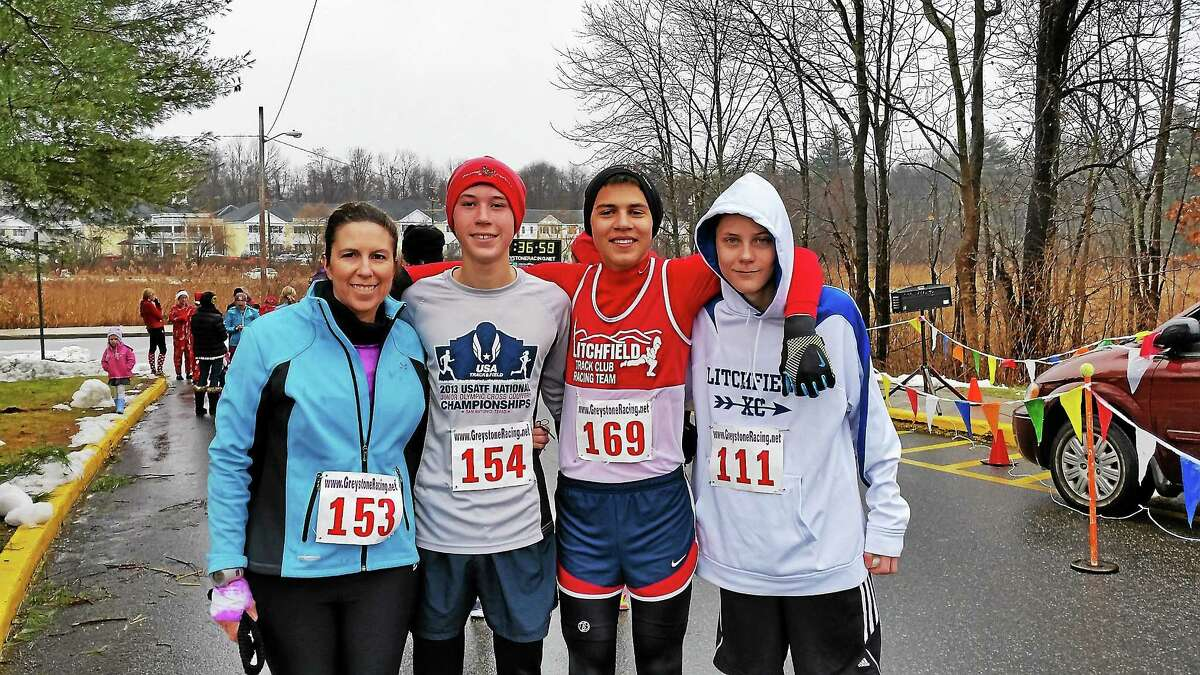 Jen Mello, 45, of Litchfield; her son Peyton Mello, 15; Antonio Muratori, 15; and Colin Torrence, 15, following the 32nd annual Jingle Bell Run at Litchfield Intermediate School at 35 Plumb Hill Road in Litchfield on Saturday. Photo - NF Ambery