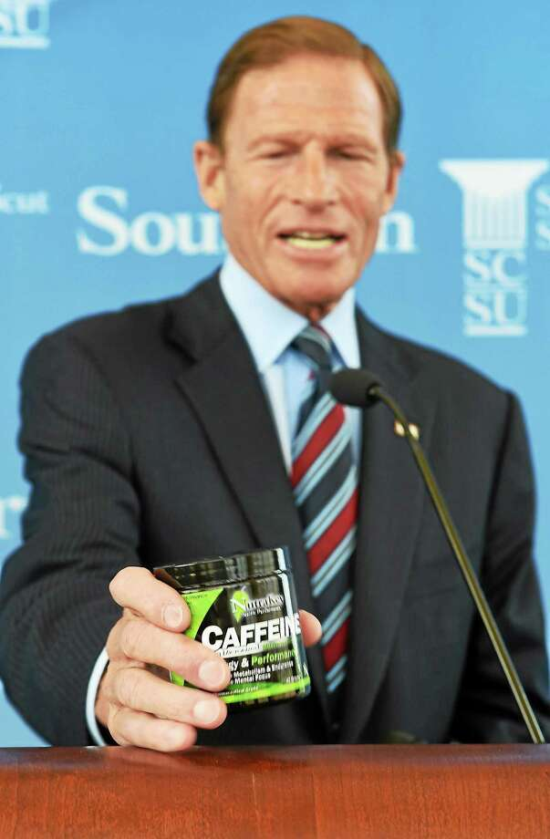 U.S. Senator Richard Blumenthal holds an example of the powdered caffeine he is asking the FDA to remove from store shelves on August 21, 2014. Photo: (Mara Lavitt — New Haven Register)   / Mara Lavitt