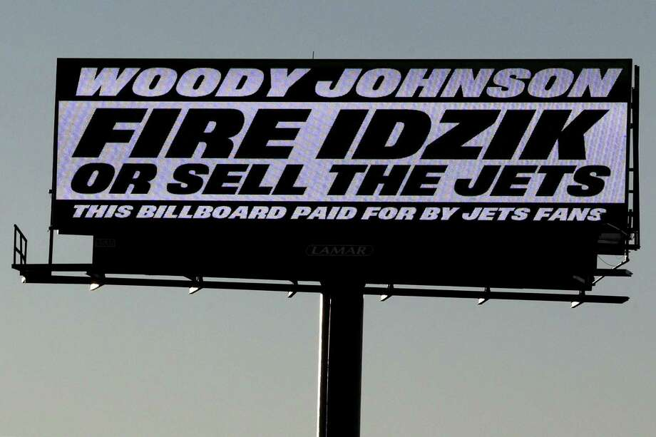 A sign directed at New York Jets owner Woody Johnson is seen on the side of Route 3 near MetLife Stadium on Nov. 28 in East Rutherford, N.J. Photo: Julio Cortez — The Associated Press  / AP