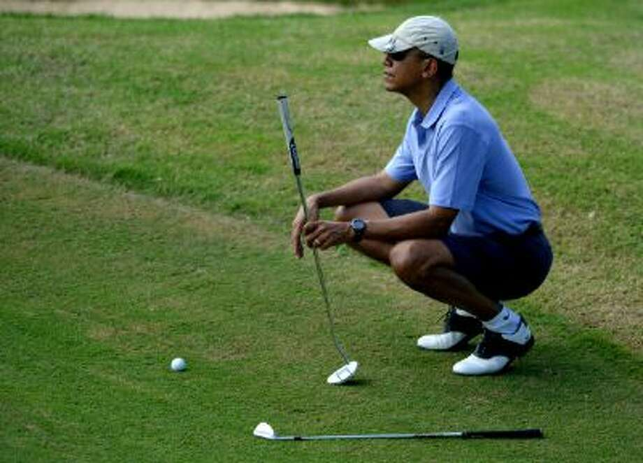 While golfing in Hawaii, Obama's aides signed him up for Obamacare to promote the law a day before the first enrollment deadline. Photo: Getty Images / 2013 Getty Images