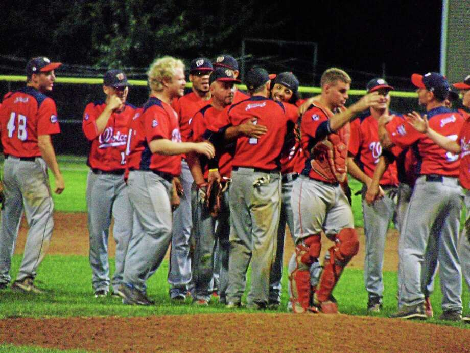 The Scrappers mob closer Manny Cruz after the final out against defending champion Tri-Town Trojans. It's Wolcott's first-ever Tri-State Championship. Photo: Peter Wallace — The Register Citizen