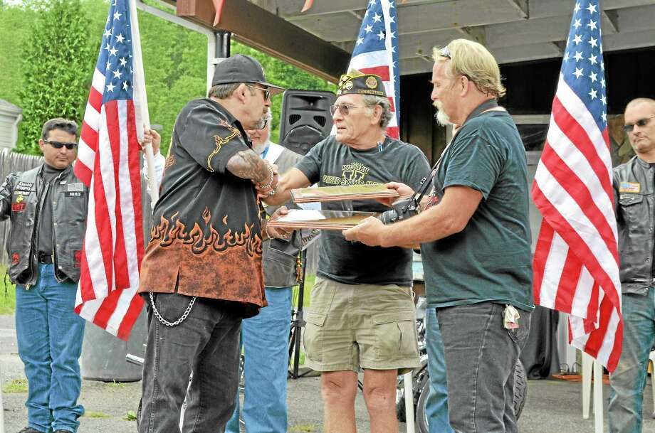 Art Melycher (Center) present plaques of appreciation to owner of the Shop, Keith Bruno (Left) and Walt Lement. Photo: Mercy Quaye—Register Citizen