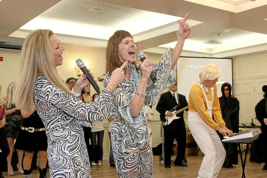 Abba performers sing during the Possum Queen Contest in Litchfield in January 2013. Photo: Register Citizen File Photo