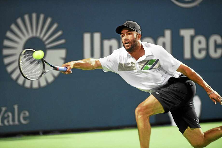 James Blake returns a shot from Jim Courier during an exhibition match on Wednesday night at the Connecticut Tennis Center. Photo: Melanie Stengel — Register