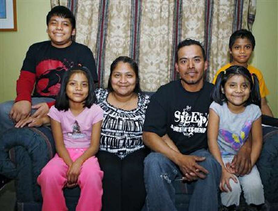 This photo taken Feb. 6, 2014, shows Abel Bautista and his wife Guadalupe posing with their four children at their home in Thornton, Colo. From left are, Kolby, 12, Wendy, 8, Guadalupe, 32, Able, 37, Kimbereli, 7, and Able, 10. Abel Bautista and his wife entered the U.S. illegally decades ago,  and have been fighting deportation ever since a traffic stop in September of 2012. Their next hearing is in October and Bautista is hoping for action from DC. Citizenship is far from his mind.?We?re just left dangling,? Bautista said. ?It?s better for each person to have citizenship, but first stop the deportations, because it?s affecting so many families.? (AP Photo /Ed Andrieski) Photo: AP / AP