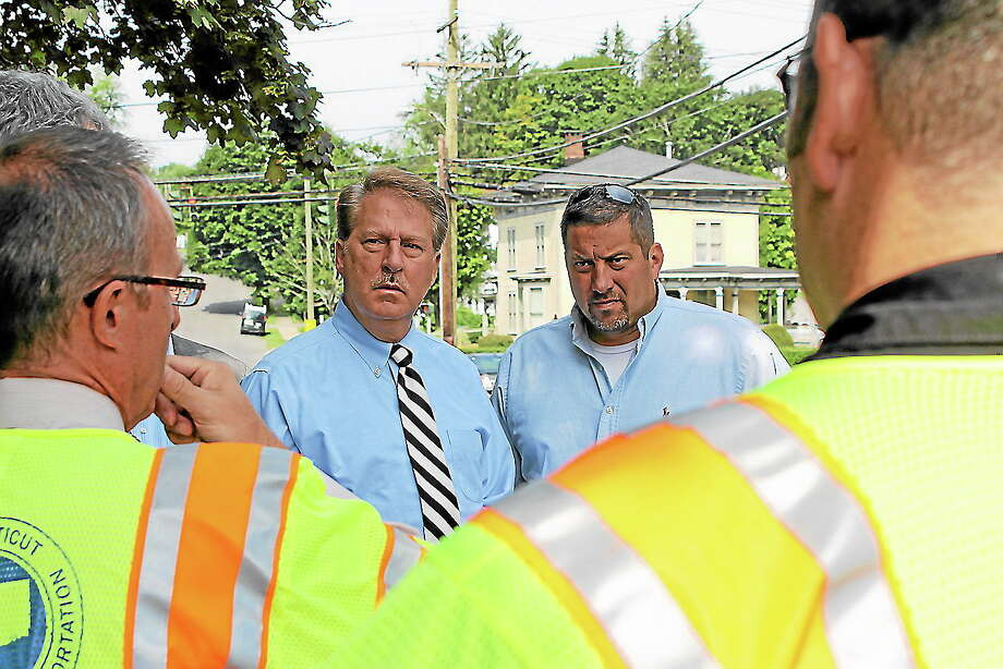 State Reps. David A. Scribner and Jay Case talk with state Department of Transportation officials about infrastructure improvements needed to Winsted's Holabird Avenue Bridge on Monday, Aug. 19. Photo: Contributed Photo