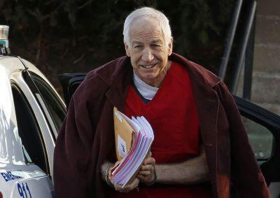 In this Jan. 10, 2013, file photo, former Penn State assistant football coach Jerry Sandusky arrives at the Centre County Courthouse for a post-sentencing hearing in Bellefonte, Pa. Photo: AP / AP