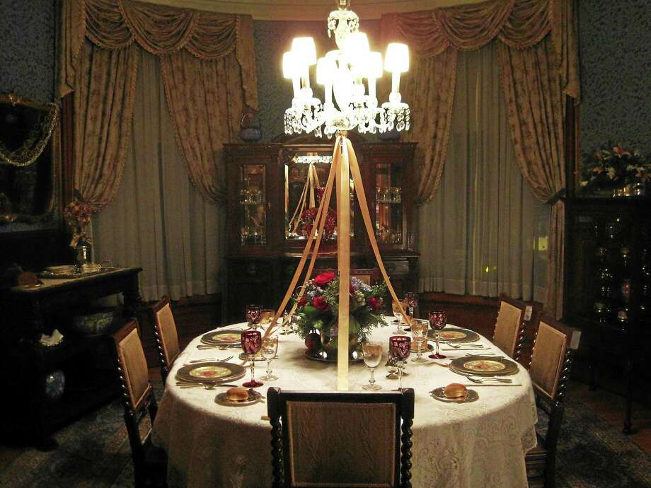 The dining room at the Hotchkiss-Fyler House Museum in Torrington is decorated with antiques for the holidays. Photo: Contributed Photo