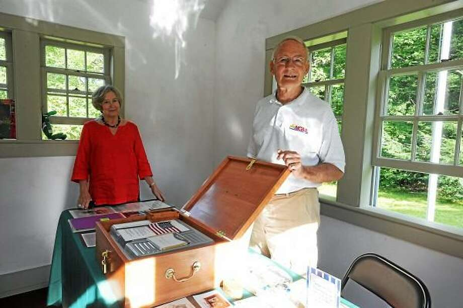 Michael and Judy Hurd pose with a time capsule at the reopening of the school. (Laurie Gaboardi-Register Citizen)
