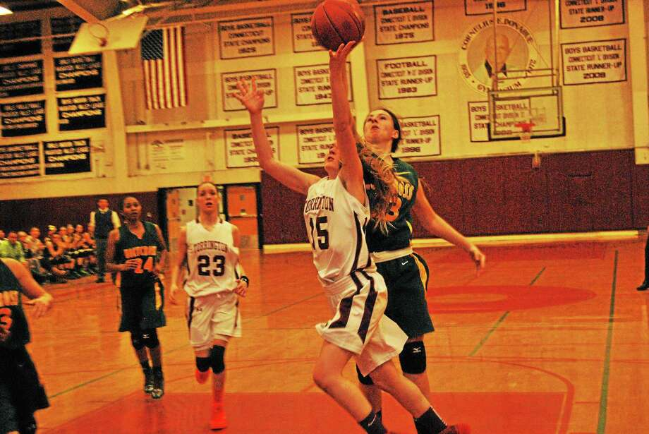 Torrington's Caroline Teti goes for a layup in the Red Raiders 52-43 loss to Holy Cross. Teti finished with a team high 22 points. Photo: Jorge Rodriguez — Special To The Register Citizen