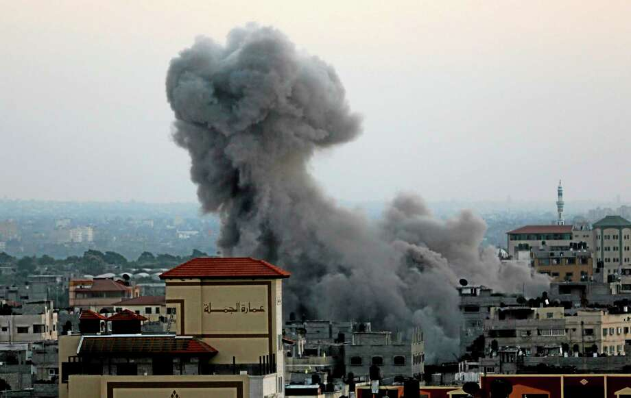 Smoke and dust rise after an Israeli strike hit Gaza City in the northern Gaza Strip, Wednesday, Aug. 20, 2014. (AP Photo/Adel Hana) Photo: AP / AP