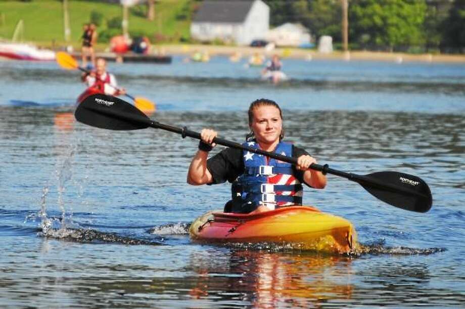 "A race participant returns from Holland Beach, back to Resha Beach during the fifth-annual Highland Lake ""It's All About Fun"" relay on Aug. 17, 2013. (Jessica Glenza-Register Citizen)"