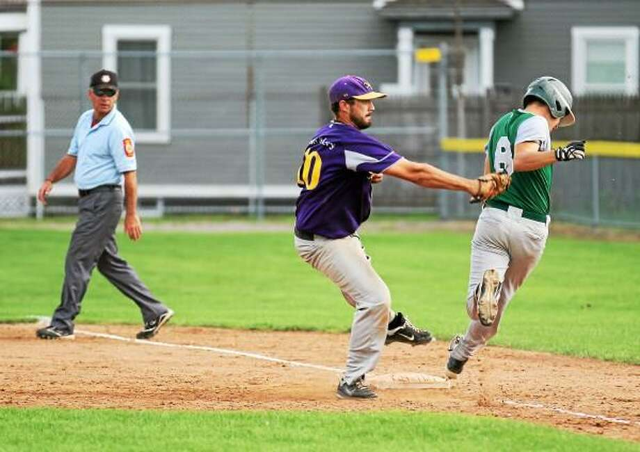 Marianne Killackey--Special to the Register Citizen Tri-Town's first baseman Joe Bunnel tags Bristol's Jimmy Hahn for the out. / 2013