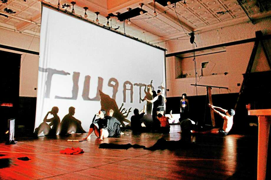 """Members of Catapult Entertainment prepare for a run-through rehearsal of their """"shadow art"""" performance in Torrington on Friday. The group is rehearsing for their upcoming performance on the NBC performance show """"America's Got Talent"""", which will be aired live on Tuesday. Photo: Esteban L. Hernandez—Register Citizen"""