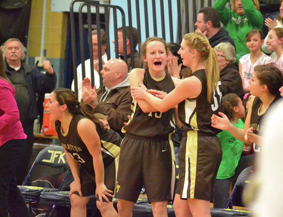 Thomaston's Charlie Eberhardt (left) and Casey Carangel (right) cheer on their teammates in the Golden Bears 43-32 win over Sacred Heart in the Class S semifinals. Photo: Pete Paguaga — Register Citizen