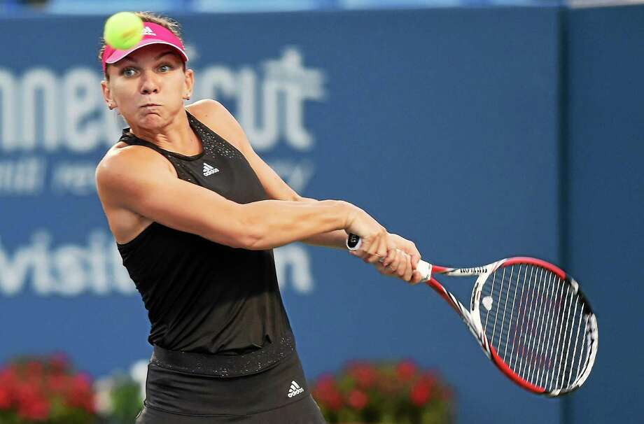 The Connecticut Open's top seed and defending champion Simona Halep lost to Magdalena Rybarikova on Tuesday night at the Connecticut Tennis Center. Photo: Melanie Stengel — Register