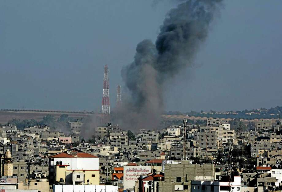 Smoke rises after an Israeli strike hit Gaza City in the northern Gaza Strip, Tuesday, Aug. 19, 2014. The Israeli military said it carried out a series of airstrikes Tuesday across the Gaza Strip in response to renewed rocket fire, a burst of violence that broke a temporary cease-fire and endangered negotiations in Egypt over ending the month long war between Israel and Hamas. The fighting occurred some eight hours before a temporary truce was set to expire. Photo: AP Photo/Adel Hana / AP