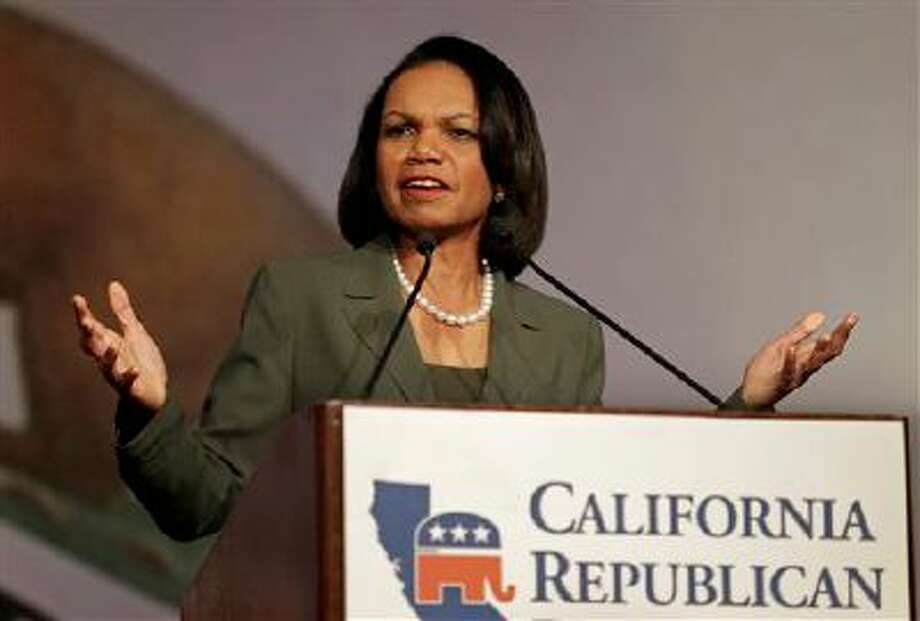 Former Secretary of State Condoleezza Rice gestures while speaking before the California Republican Party 2014 Spring Convention Saturday, March 15, 2014, in Burlingame, Calif. (AP Photo/Ben Margot) Photo: AP / AP